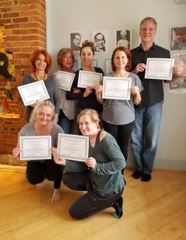 Seven Reiki 1 students holding certificates