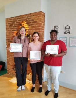 Three Reiki 1 students holding certificates