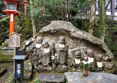 Statues of children on the Mount Kurama path