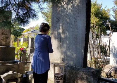 Kandi Austin praying at the Mikao Usui memorial stone