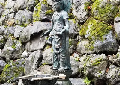 A statue of Kwan Yin at the entrance to Mount Kurama
