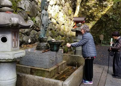 Kandi Austin in a cleansing ritual at the entrance to Mount Kurama