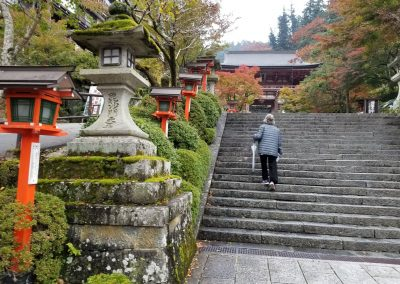 Kandi Austin at the entrance to Mount Kurama. Fall is a beautiful time to visit. I was so excited to walk up these steps.