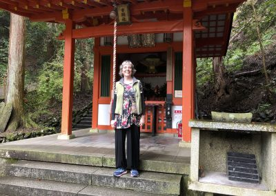 Kandi Austin at a small shrine on the path to Kurama-dear temple